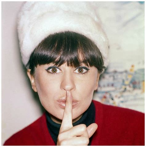Picture of Astrud Gilberto with her finger indicating ssh